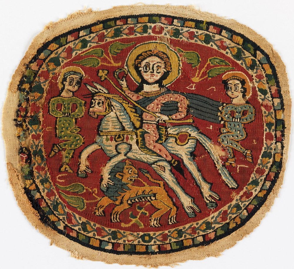 Image of 6th Century Roundel from  Love to Know . Roundels like this commonly adorned the shoulder areas of children's garments.
