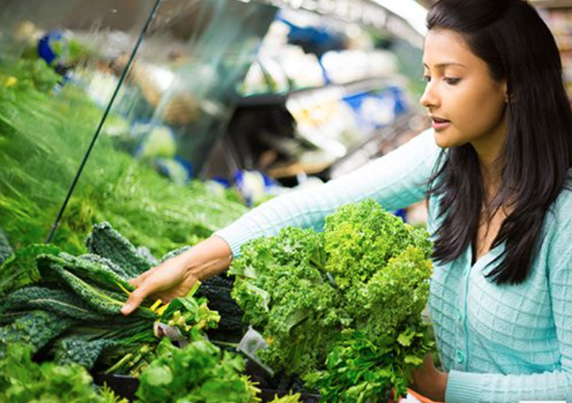 woman shopping for greens.jpg