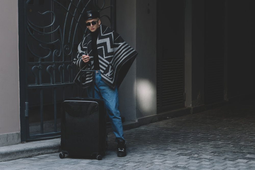 Ruslan Baginskiy Leather Baker Boy Hat x Le Specs x Adam Selman Sunglasses x MSGM turtleneck x Louis Vuitton Karakoram Plaid x MSGM high-top sneakers x Raden Suitcase
