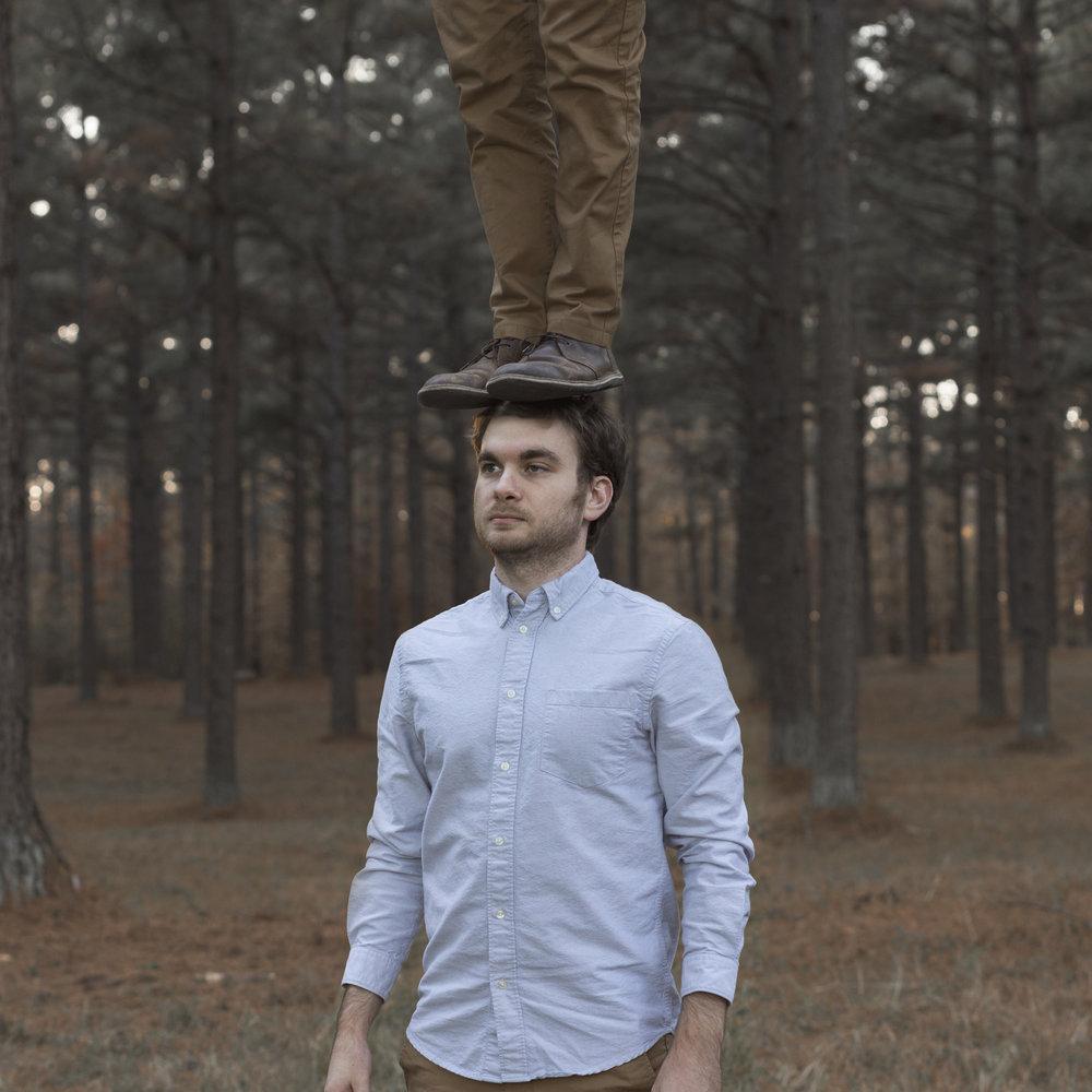 me_standind_on_my_head_woods.jpg