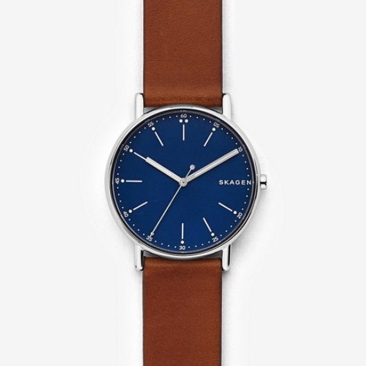 SKAGEN ,   Signatur Leather Watch,  $125  Feel like really spoiling your man? A watch is a great gift, something they'll treasure forever. This simple style could be paired with any outfit, the brown leather strap with the royal blue face compliment each other perfectly. This brand is also available at Hudson Bay.