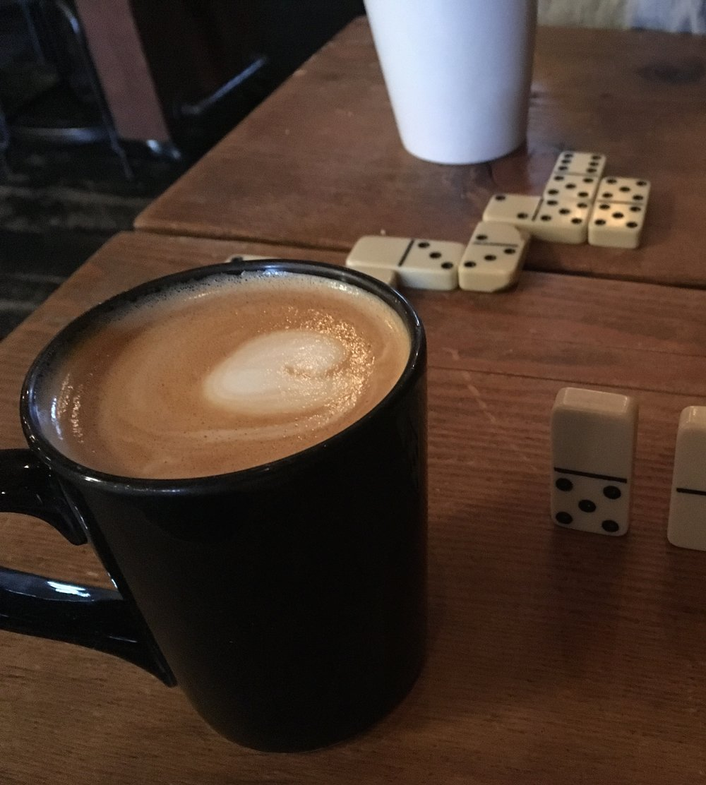Enjoying my maple latte over a game of dominos