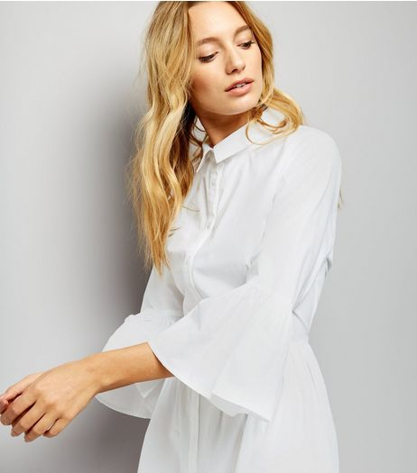Check out this option from  NEW LOOK , 'White Bell Sleeve Cotton Shirt Dress' 22.99