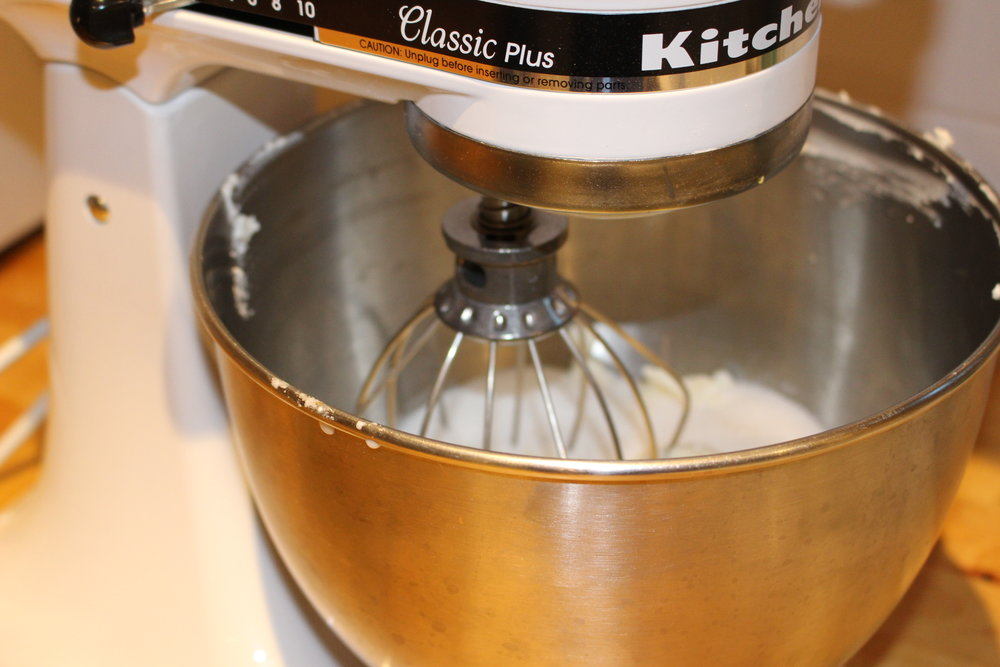 Mixing up the ricotta, sugar and grand marnier mixture