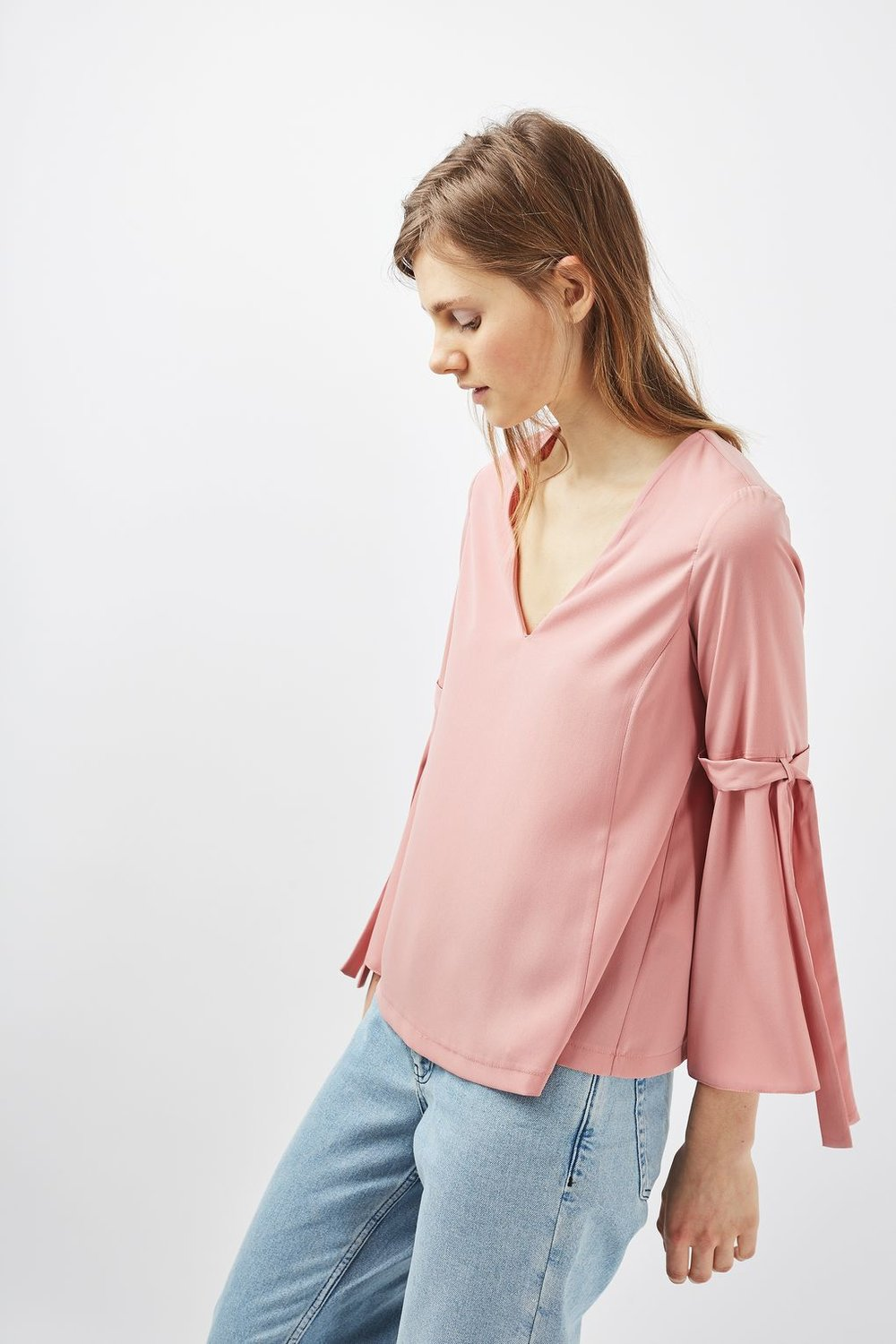 Check out this option from  TOPSHOP  'Tie Sleeve Blouse' $60,