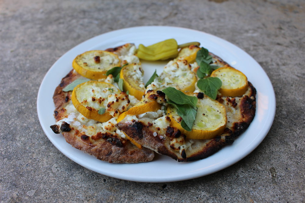 Delicious pizette with summer squash and goat cheese