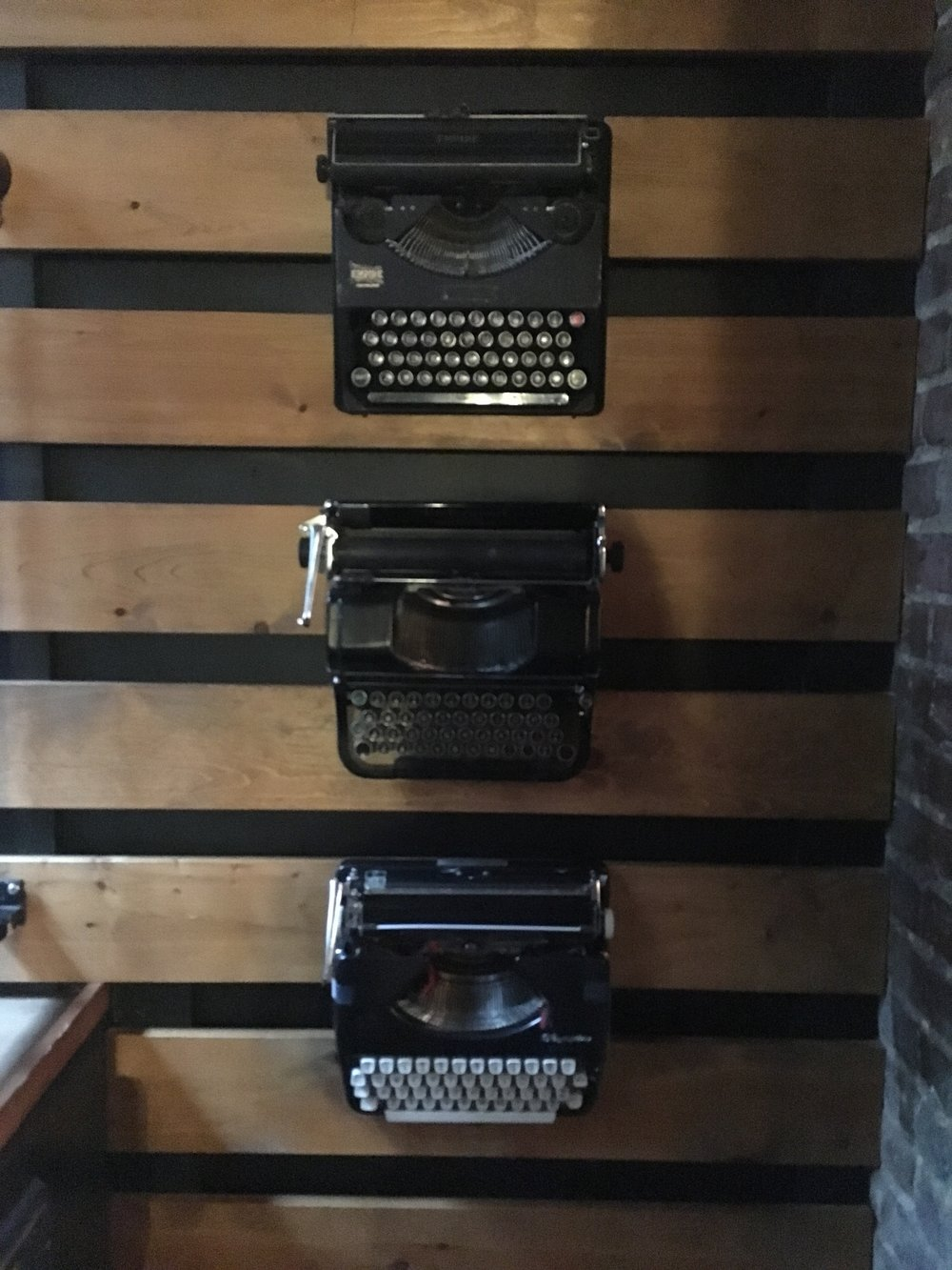 Old typewriters displayed on one of the walls