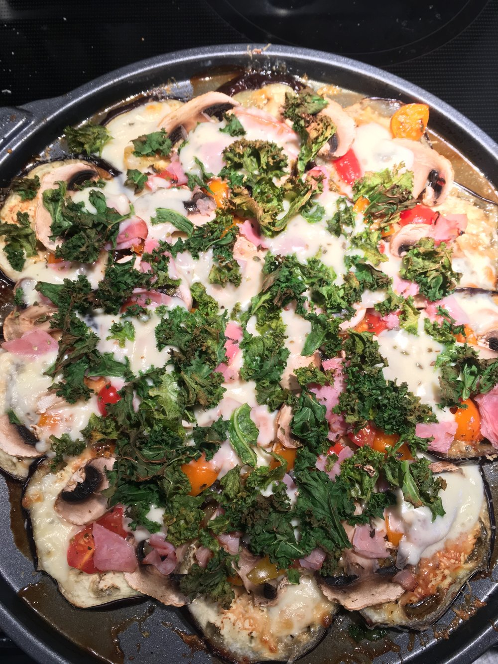 The finished products with mozzarella, ham and kale