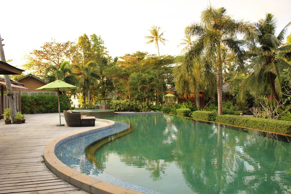 One of the resort's pools surrounded by beautiful gardens