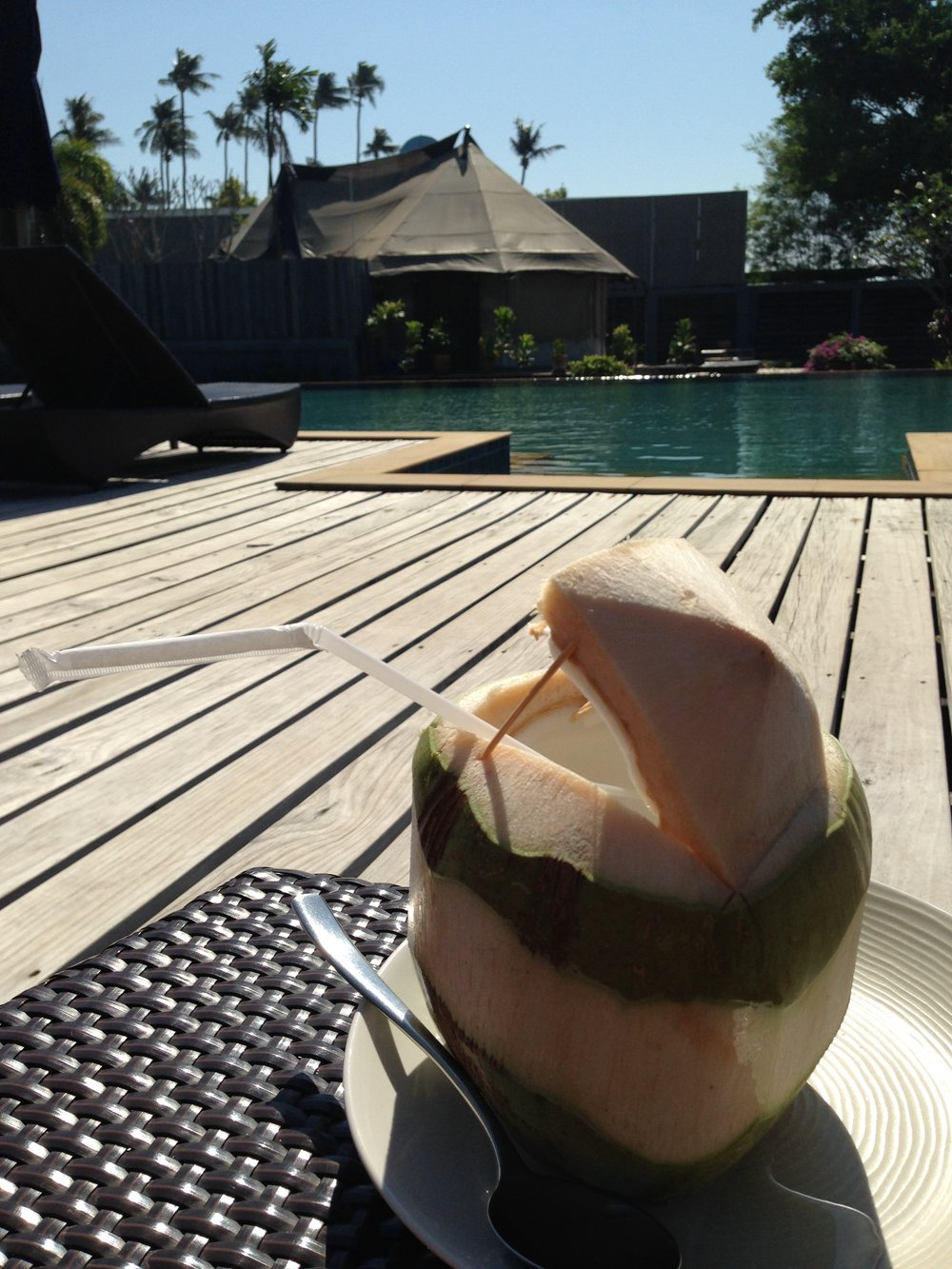 Poolside with a coconut