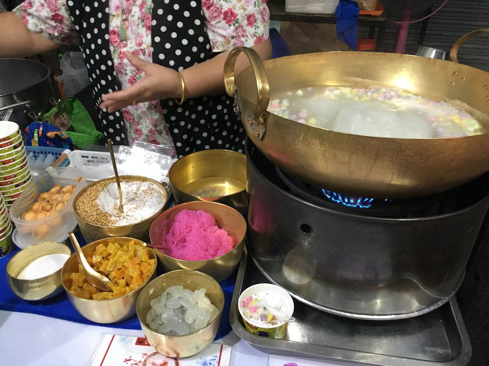 The delicious toppings and the sticky rice balls boiling away