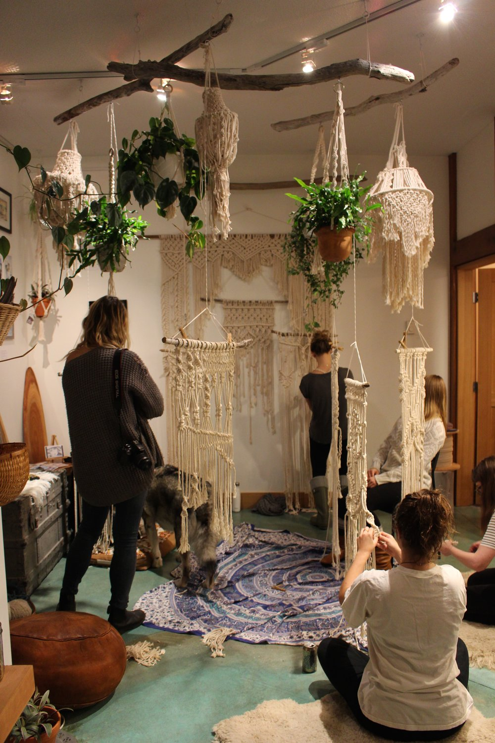 Everyone working on their own macrame pieces