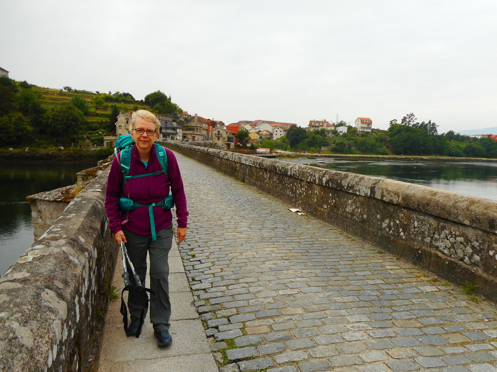 My mum crossing one of the medieval bridges