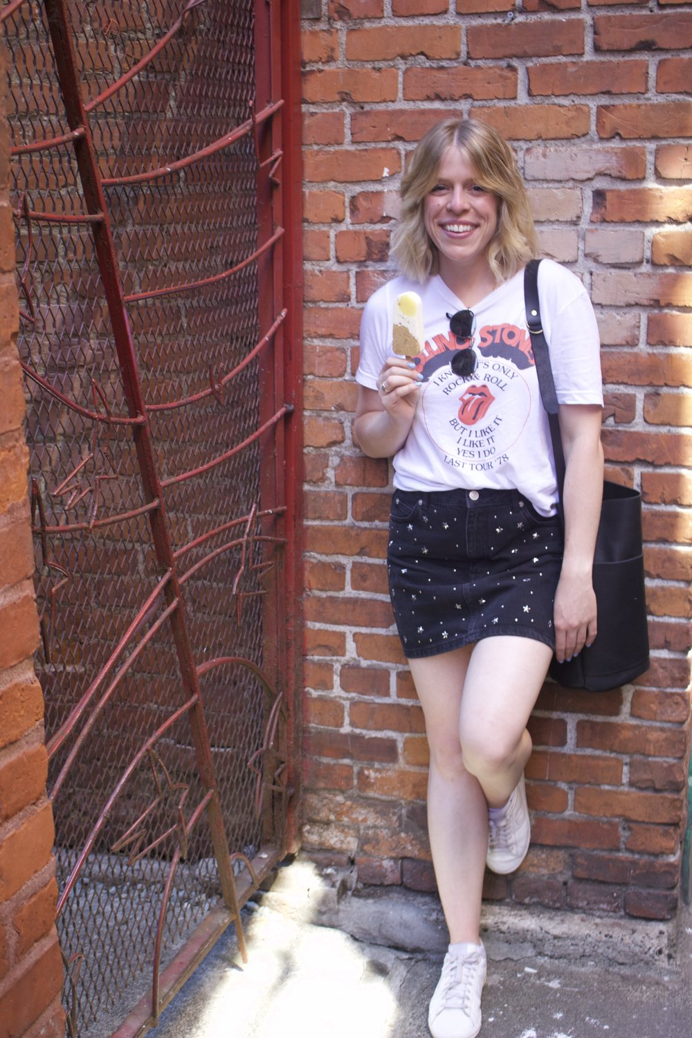 American Eagle    Rolling Stones T-Shirt,    Topshop    Skirt,    Nike    Sneakers,    Market Canvas Leather    Bucket Bag,    Ray Ban    Sunglasses