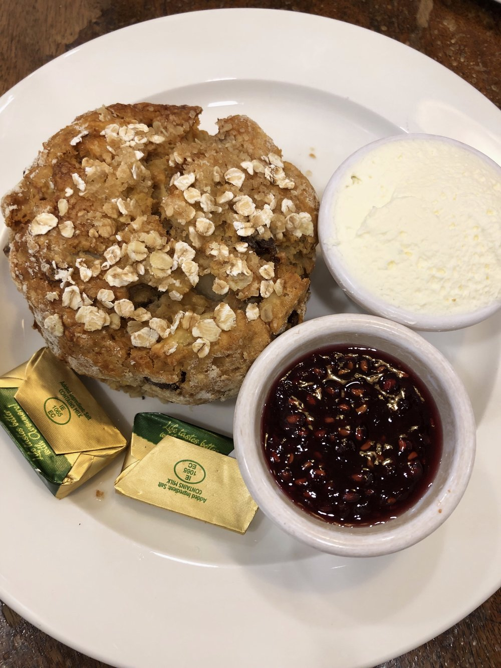 Oat, date and apple scone with jam, clotted cream and delicious Irish butter