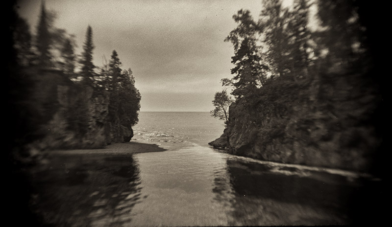 Temperance River flowing into Lake Superior. Taken on a vintage Agfa folding camera with 120 Tr-X film.