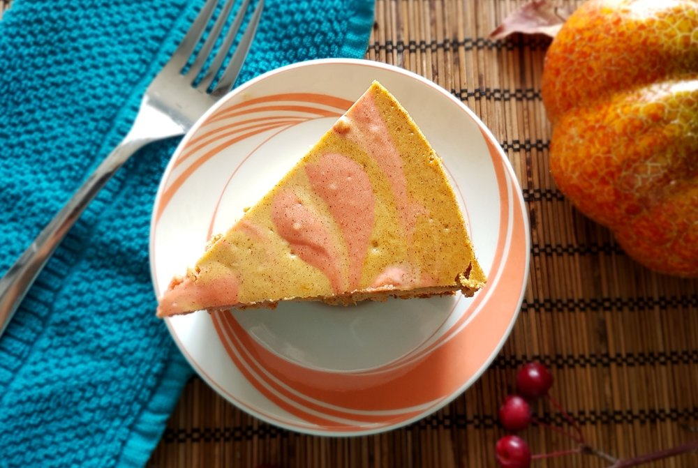 a slice of Baked Pumpkin Cheesecake, viewed from above