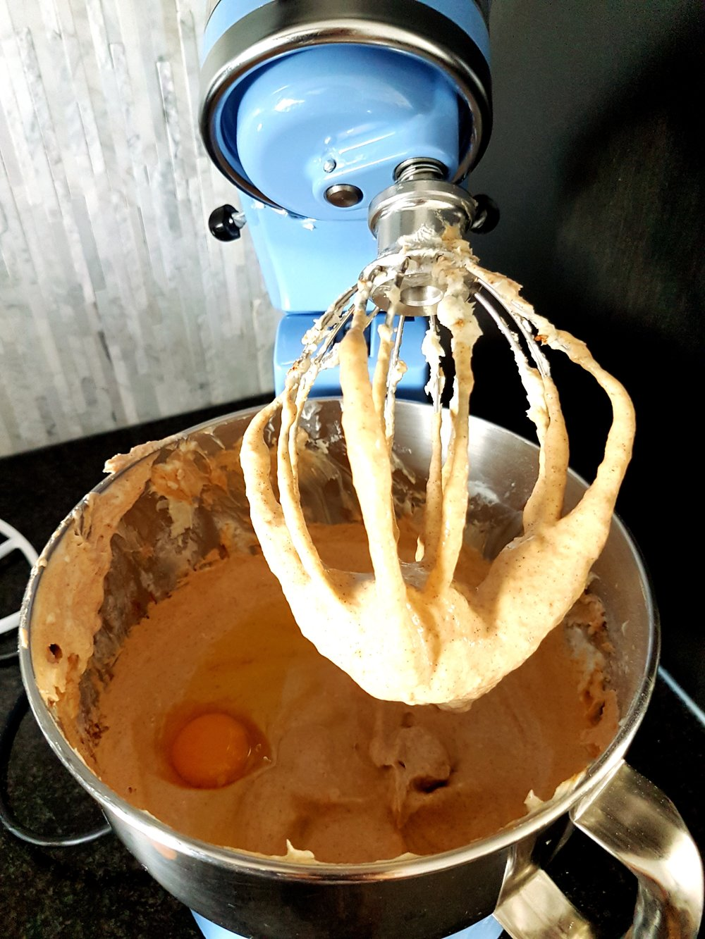 Cheesecake batter in a stand mixer.