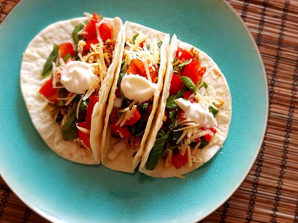 three loaded Fresh Cilantro Lime Chicken Tacos on a plate, ready for eating
