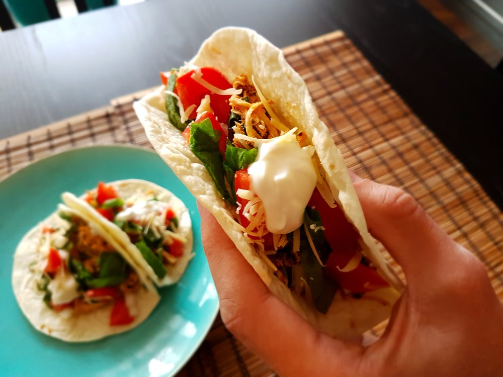 a Fresh Cilantro Lime Chicken Taco makes the journey from plate to mouth
