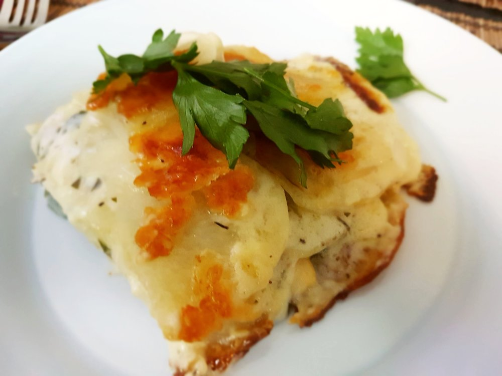 a Creamy Potato Cheese Gratin with a crispy top, garnished with parsley