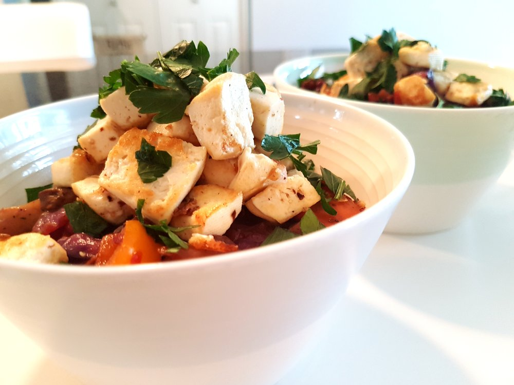 two hot bowls of Quinoa with Fresh Vegetables and Tofu