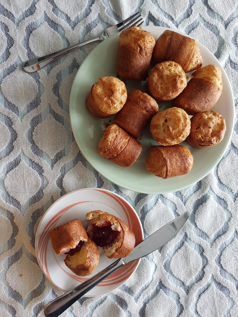Ingredient Popovers, two on a plate, cut in half and filled with jam ...