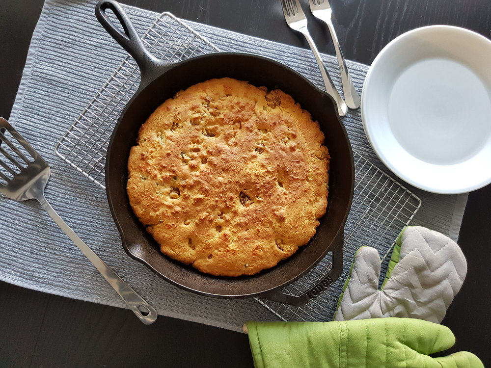 Spicy Jalapeno and Hot Italian Sausage Cornbread, hot from the oven in a cast iron skillet