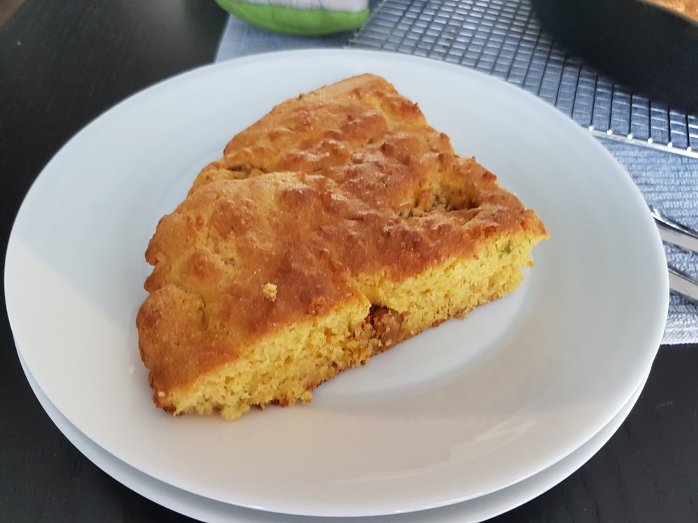 a slice of Spicy Jalapeno and Hot Italian Sausage Cornbread