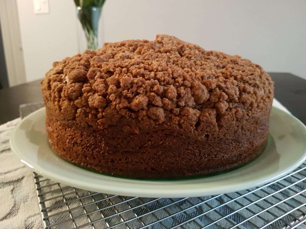 a whole Pumpkin Sour Cream Coffee Cake complete with crumble topping