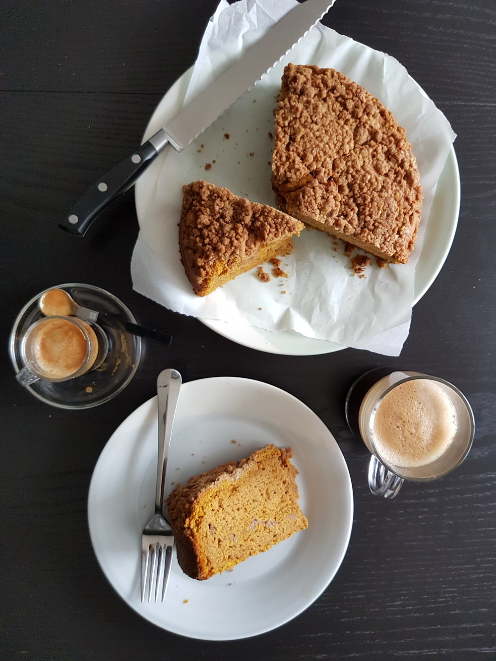 a slice of Pumpkin Sour Cream Coffee Cake with a cup of coffee on the side