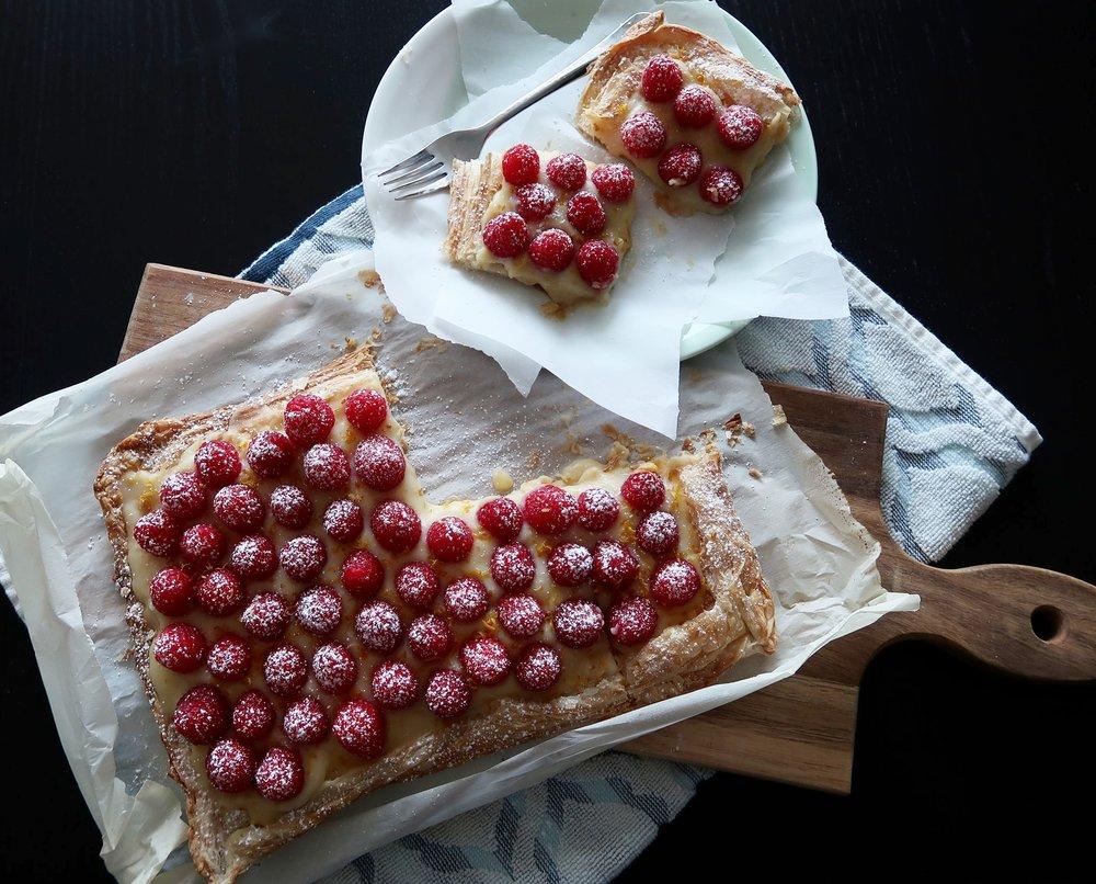 Fresh Raspberry Lemon Curd Tart sprinkled with icing sugar