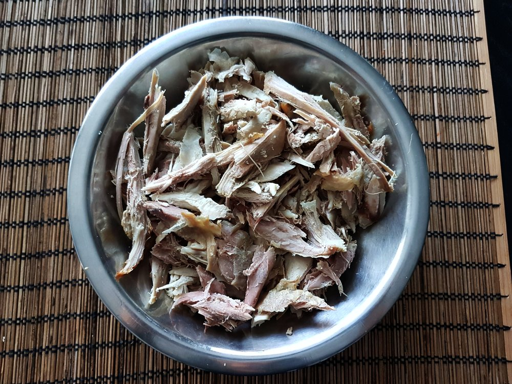 shredded leftover turkey in a metal bowl