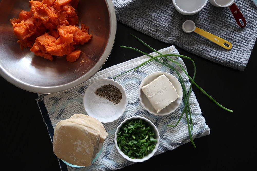 mashed sweet potato alongside cream cheese, green onions, salt, pepper, and wonton wrappers
