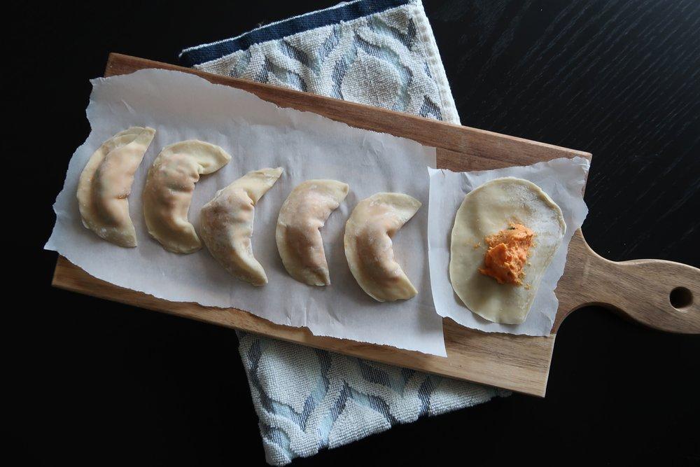 five newly-wrapped Sweet Potato Dumplings in a row