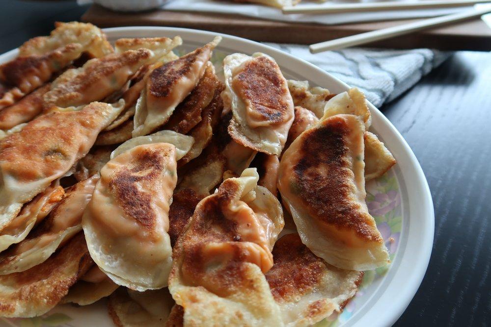 a plate of Sweet Potato Dumplings fresh from the frying pan