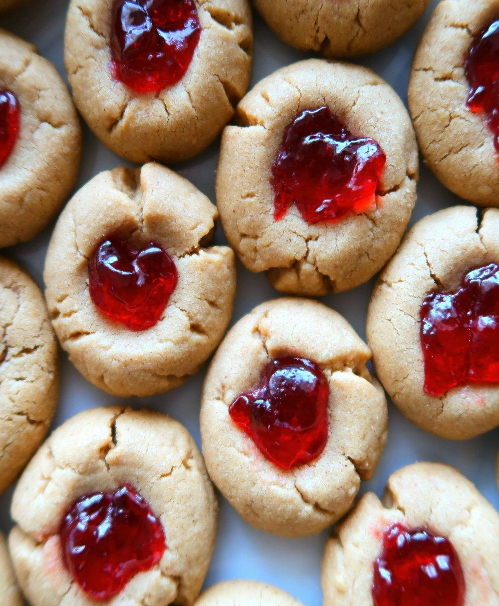 peanut butter thumbprint cookies filled with jelly