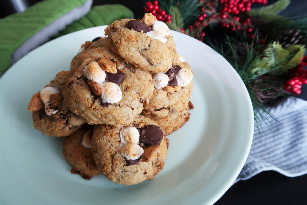 A pile of Soft and Chewy S'more Cookies on a plate.