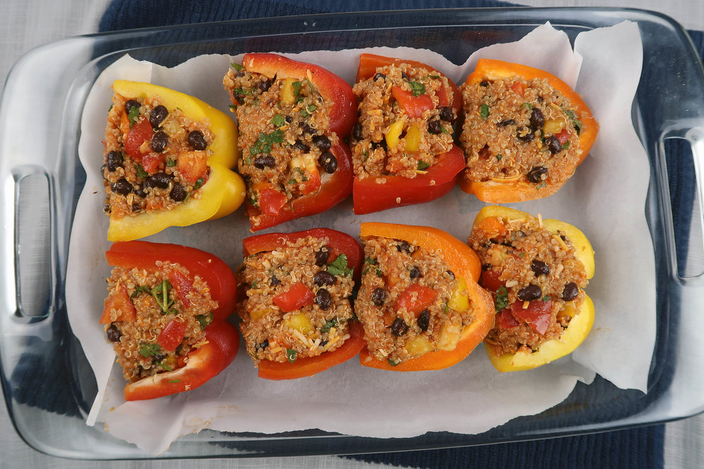 Stuffed bell peppers in a baking dish.