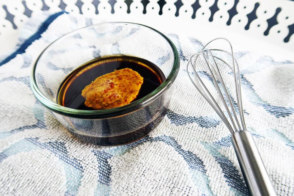 Balsamic vinegar and honey mustard in a bowl.