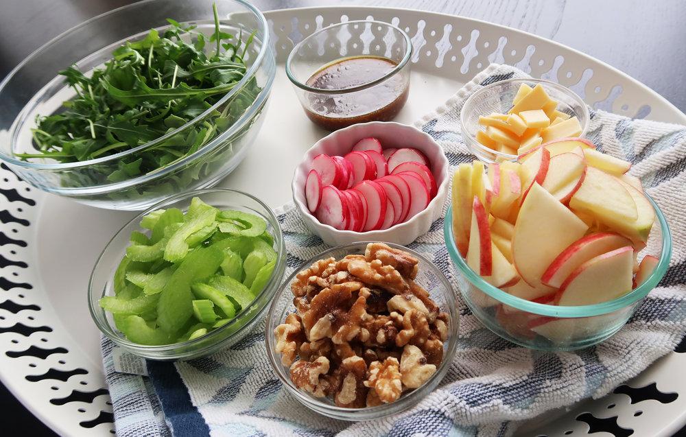 Arugula, celery, radishes, apples, walnuts, and dressing.