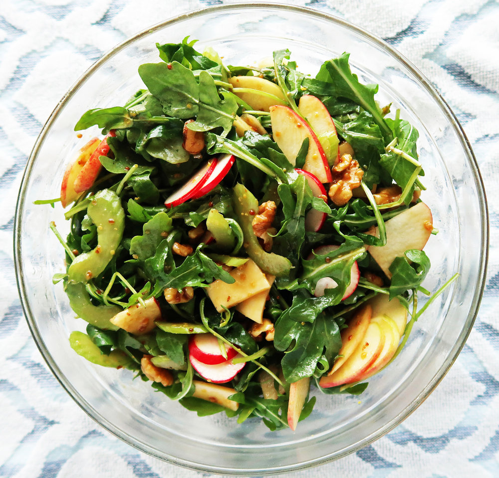 Arugula, celery, apple, and walnut salad tossed with balsamic honey mustard dressing.