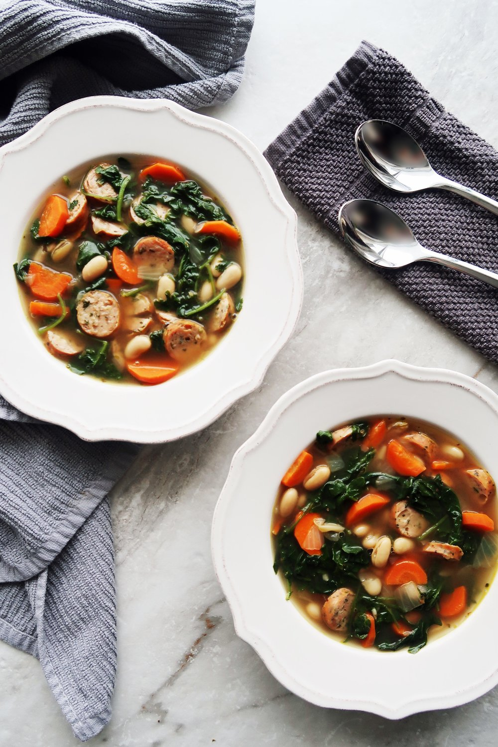 Two bowls of Kale, White Bean, and Sausage Soup