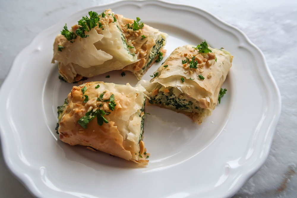 Spinach and Ricotta Spanakopita Rolls cut in half and stacked.