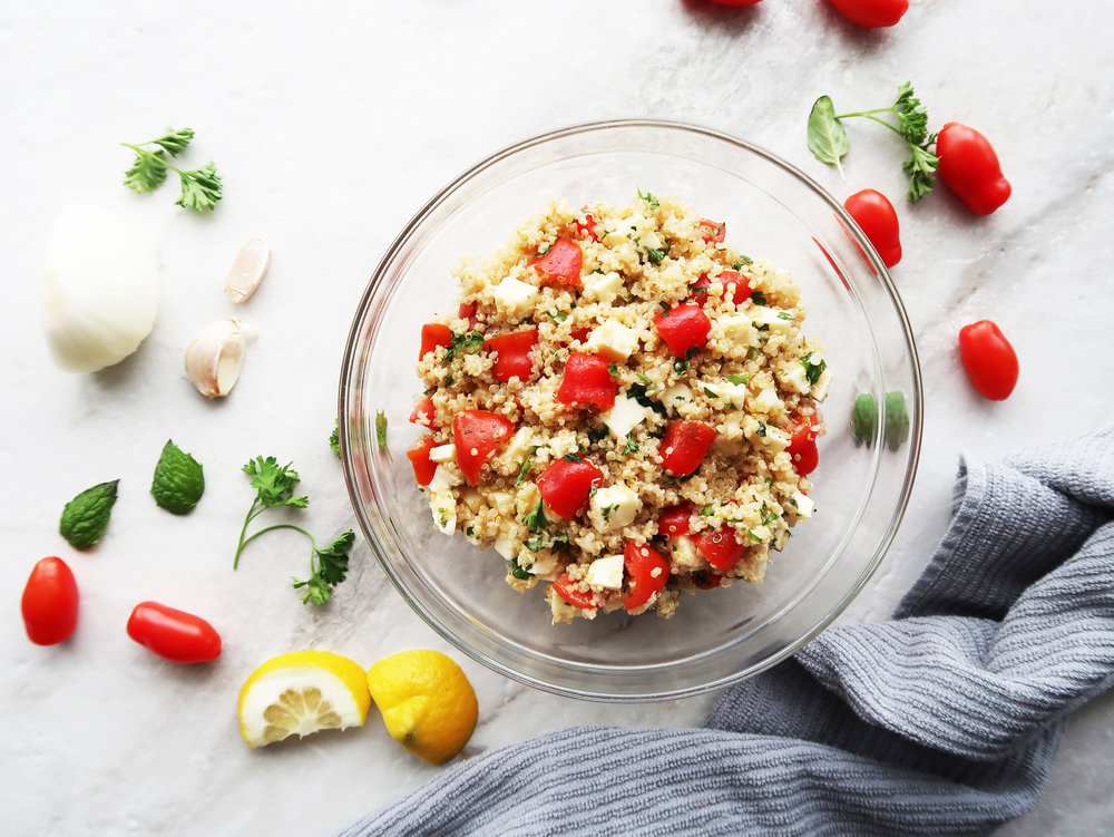 Fresh Tomato, Mozzarella, and Herb Quinoa Salad surrounded by ingredients.