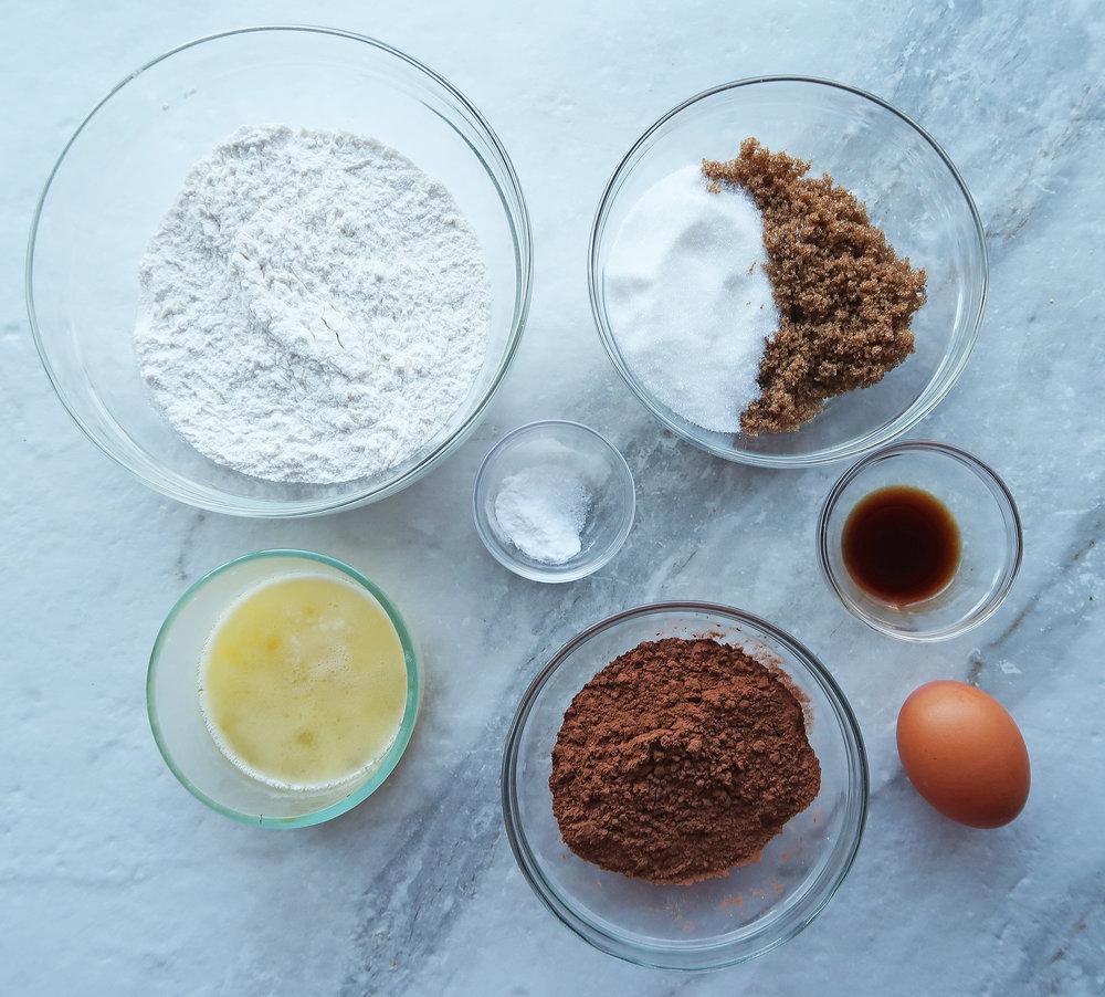 Flour, sugar, cocoa powder, butter, eggs, and vanilla.