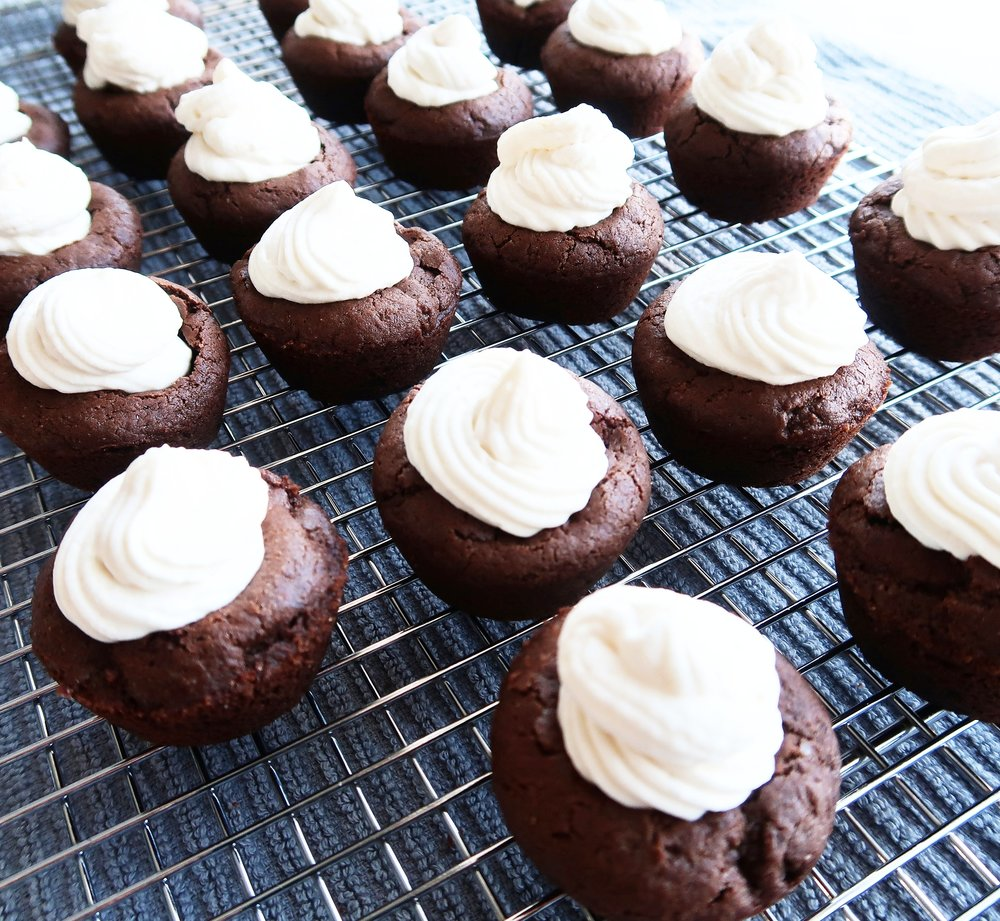Chocolate cookie cups filled with cream.