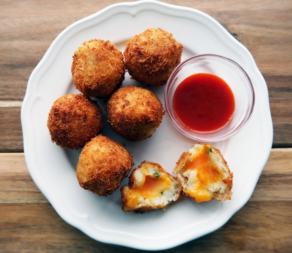 A plate of 5 Ingredient Crispy Mashed Potato Cheese Balls.