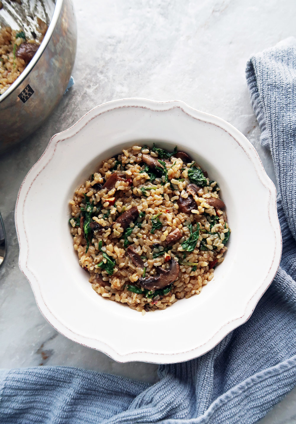 A bowl of Brown Rice Pilaf with Mushrooms, Kale, and Almonds