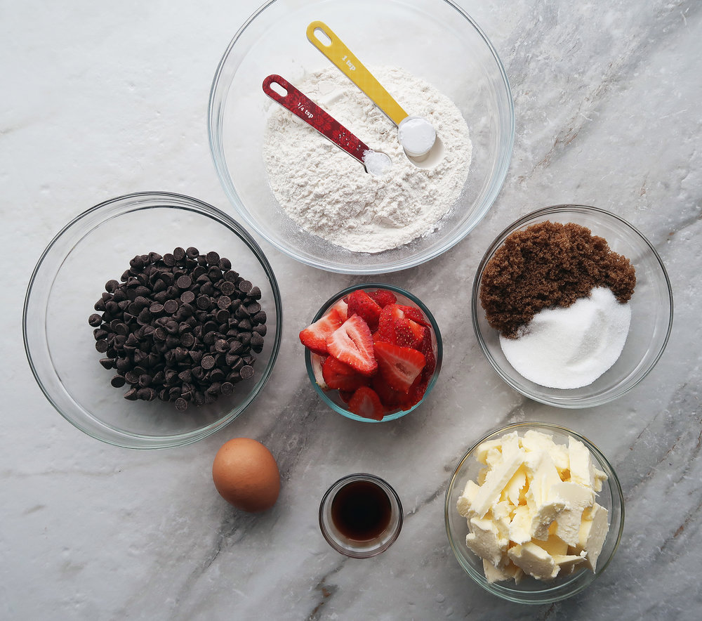 Chocolate chips, strawberries, flour, sugar, an egg, butter, and vanilla.